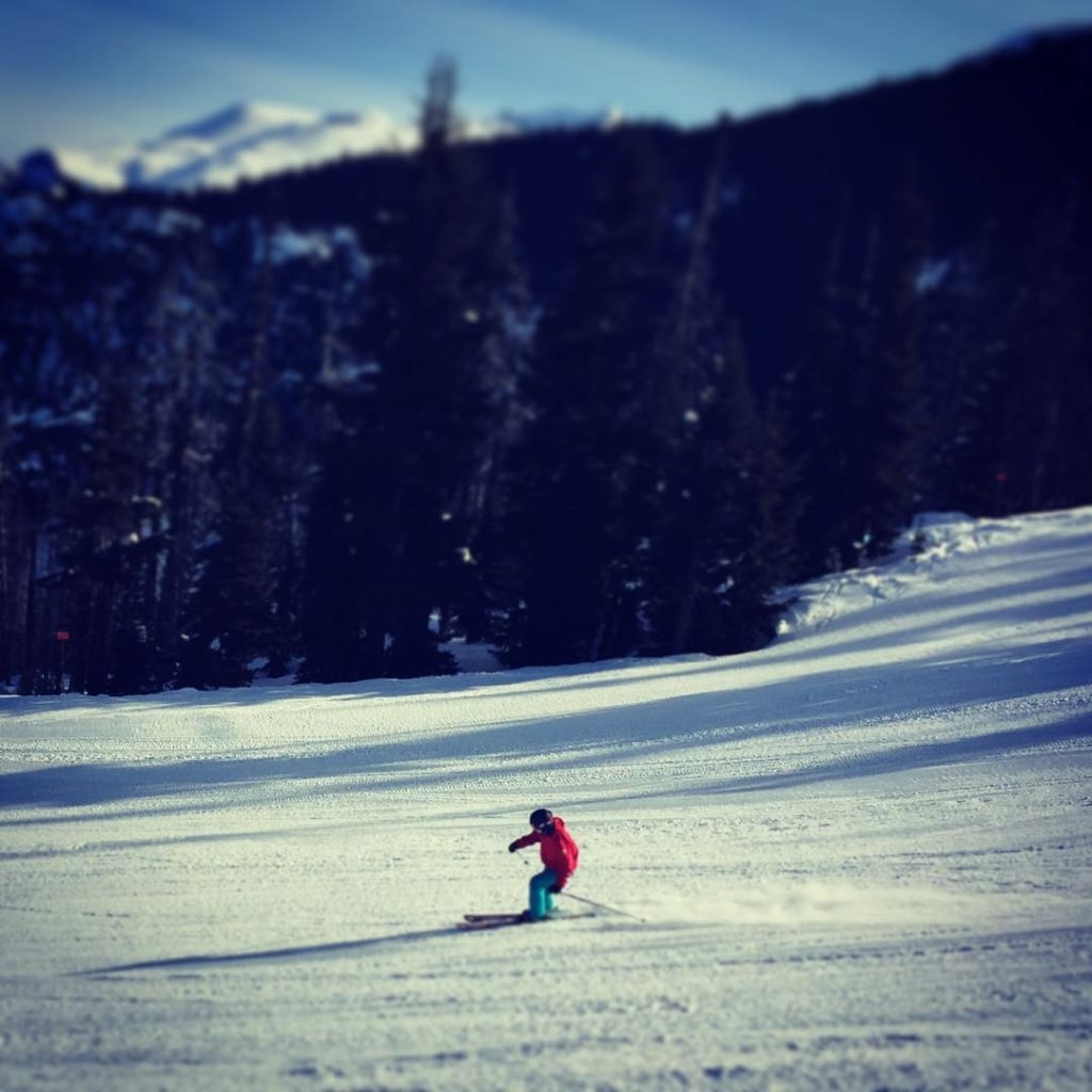 Lee skiing down Blackcomb side